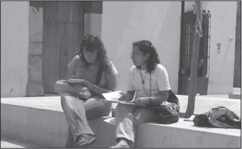PBI volunteer speaks with WHRD Sara Mendez in Oaxaca City